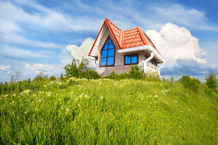 small country town: small house with red roof on a sunny hill