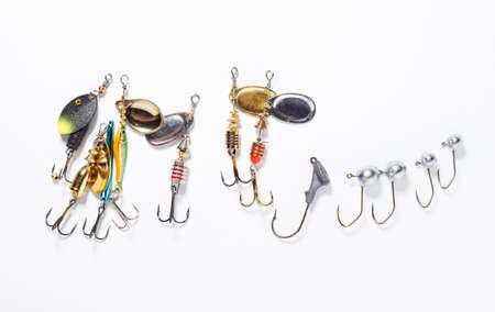 jigging: fishing hooks with bait on white background