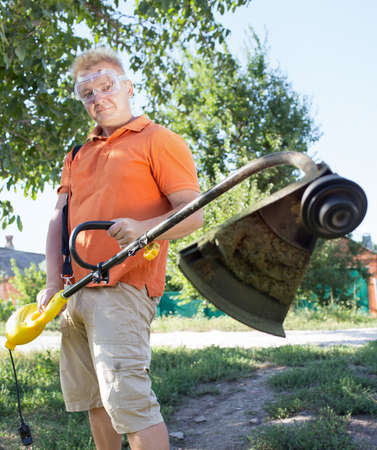 man working with lawn mower photo