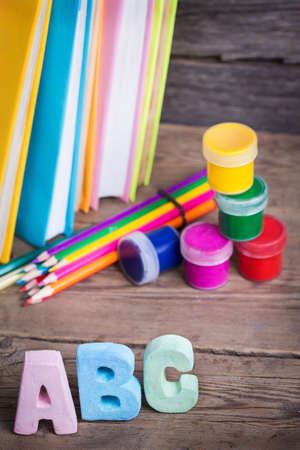 school supplies labeled ABC on a wooden background photo