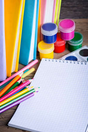 school supplies on a wooden background photo