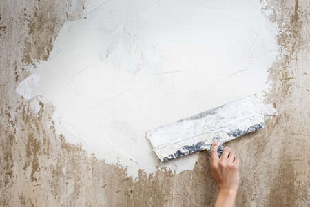 spatula with putty on the wall photo