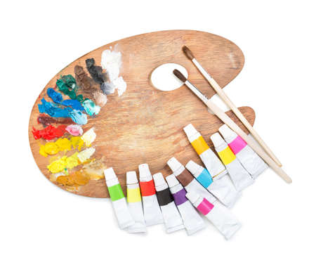 color palette: palette with tubes of paint and brushes on a white background Stock Photo