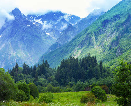 elbrus: The tops of the mountains. Village Dombay, Karachay Cherkessia Republic, Russia