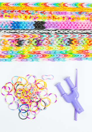 infatuation: Rainbow loom- Colored rubber bands for weaving accessories Stock Photo