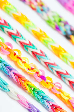 wicker work: Rainbow loom- Colored rubber bands for weaving accessories Stock Photo