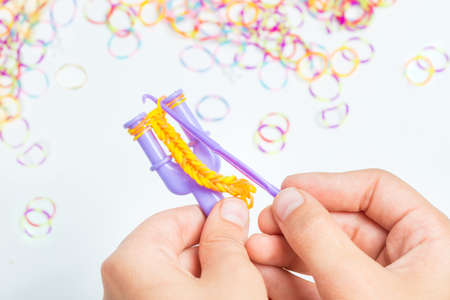 bangles hand: Rainbow loom- Colored rubber bands for weaving accessories Stock Photo