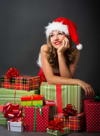 young woman in a Christmas costume on a black background