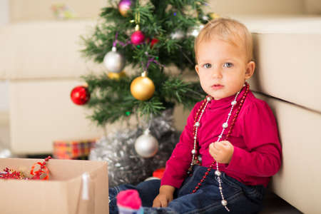baby near christmas tree: Happy baby near Christmas tree