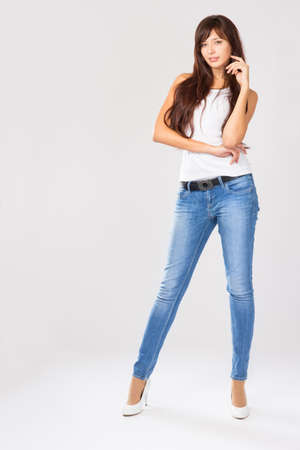 brunette in jeans in the studio
