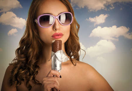ice cream woman: Young beautiful woman in sunglasses with ice cream Stock Photo