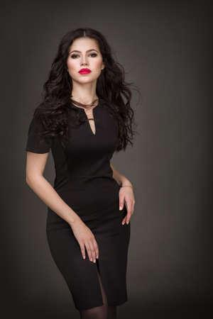 pretty hair: Seductive brunette in a black dress