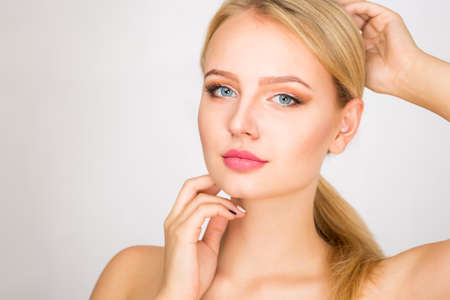 caucasian white: Face of a beautiful young woman on a white background