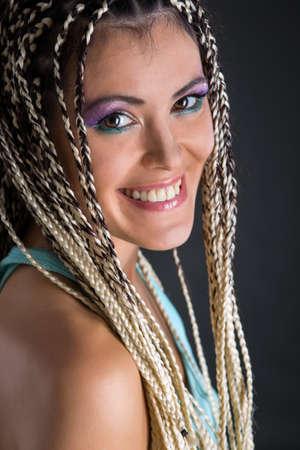 rastas: Girl with dreadlocks in the studio.