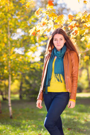 autumn young: Young woman in autumn park