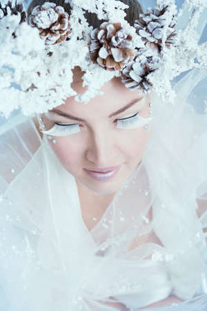 the enchantress: Face of a young woman on a snowy background