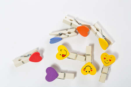 set of colored pegs with insertions on a white background Stock Photo