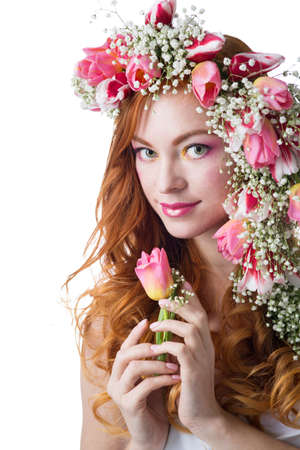 young woman with red hair wearing a wreath of tulips