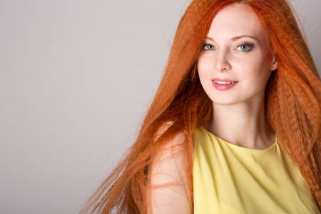 Young red-haired woman with long hair Stock Photo