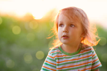 A little girl of three years in the open air Stock Photo