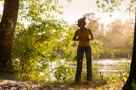 A woman is standing on the river bank