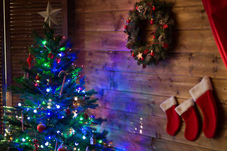 merry christmas decoration wreath near christmas tree with lights stock photo 90013783