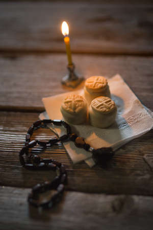 Prosfora from the Orthodox Church and a burning candle Stock Photo