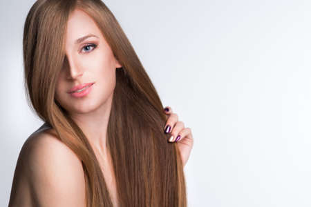 young woman with long beautiful hair, Young long-haired woman with well-groomed hair  Imagens
