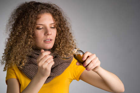 Young woman has caught a cold drink medicine Stock Photo