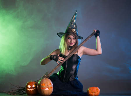 Young woman witch conjures, woman in costume on halloween Stockfoto