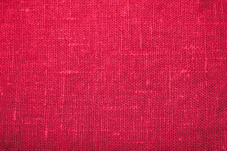The texture of a crumpled colorful red color fabric background. Weaved waffle texture of cotton linen towels, wash cloth, kitchen towel, hand towel, bath towels background. Blank red color background for layouts. Stock Photo