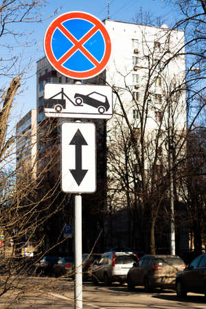 Traffic road sign prohibiting parking Parking prohibited with information Direction of sign. Evacuation on tow truck.