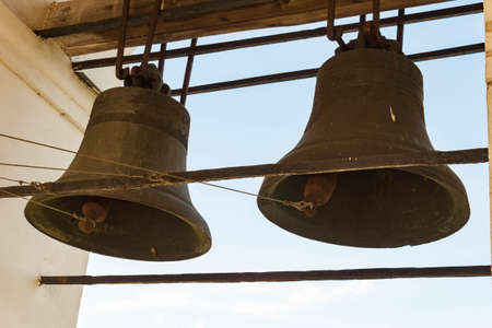 The bells in the belfry in day sky 写真素材