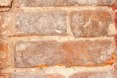 Beautiful background of rough rustic texture the shabby old vintage red brick ruined wall of the historic building 写真素材