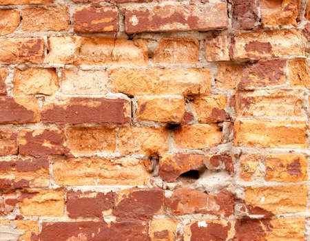 Beautiful background of rough rustic texture the shabby old vintage red brick ruined wall of the historic building Stockfoto