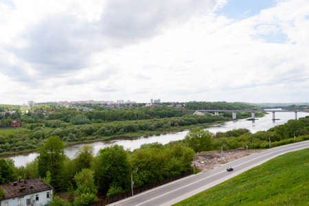 Kaluga, Russia - May 11, 2019: Entrance to the city and beautiful view of the bridge across The Oka river from the observation point in the Park of culture and recreation 写真素材