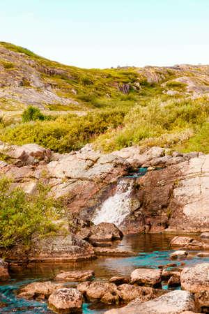 Beautiful summer day landscape waterfall North Teriberka, Barents sea view