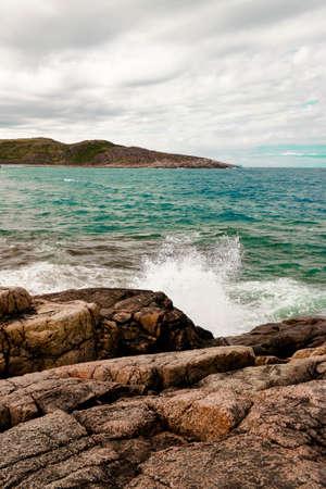 Beautiful summer day landscape waves, foam and spray Barents sea Teriberka view. North sea concept