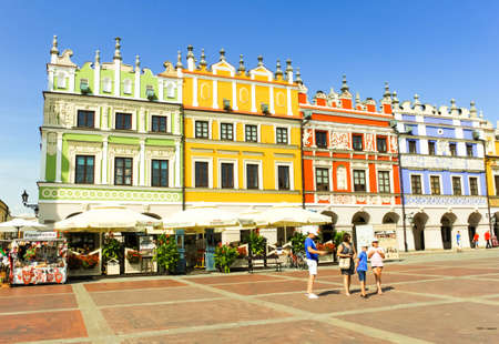 ZAMOSC, POLAND - JULY 28, 2019: colorful renaissance houses at Market Square of historical city center of Zamosc UNESCO World Heritage