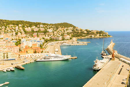 NICE, FRANCE - AUGUST 6, 2019: Beautiful above view on old harbour with yachts, sailing boats in Nice Provence Cote D Azur. Natural background view. Mediterranean tourist destination, French riviera. 報道画像