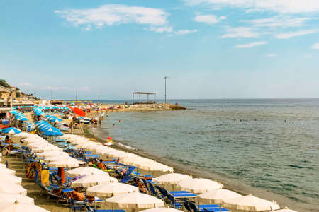 VARAZZE, ITALY- AUGUST 5, 2019: Beautiful beach of coast of Liguria and Ligurian sea on natural background view. Text copy space. Italian sea, beach concept