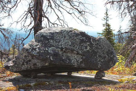 Large megalithic seid stone boulder in the nature reserve on mountain Vottovaara, Karelia, Russia. Close up. Natural background view. Lapps Sami heathen Shaman worship Hyperborea Concept