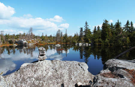 Swamp or lake with megalithic seid boulder stones, dead trees in nature reserve on mountain Vottovaara, Karelia, Russia. Natural background view. Lapps Sami heathen Shaman worship Hyperborea Concept 写真素材