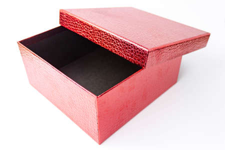 Single red color open gift paper cardboard leather embossed box on white background. Holyday present concept. Close up view. Selective soft focus. Text copy space.