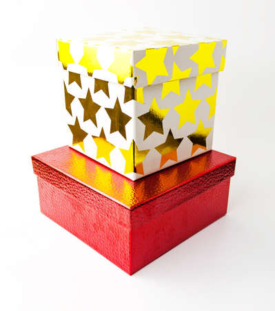 Red leather embossed and white color golden starred gift paper cardboard box on white background. Holyday present concept. Close up view. Selective soft focus. Text copy space. 写真素材