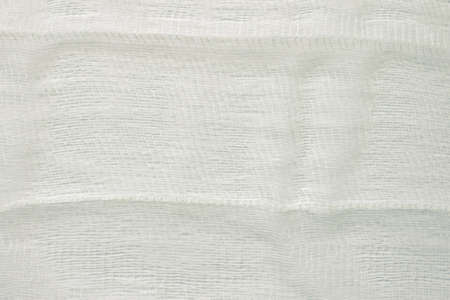 white color woven cotton gauze fabric background texture. close up top view.