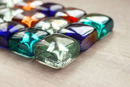 Abstract background multicolored multicolored glass cubes, crystals, transparent stones light wood 写真素材