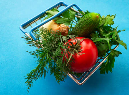 Shopping grocery cart metal on blue background. Food basket concept. Close up. Copy space. Top view 写真素材