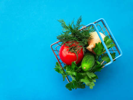 Shopping grocery cart metal on blue background. Food basket concept. Close up. Copy space. Flat Lay 写真素材 - 151368948