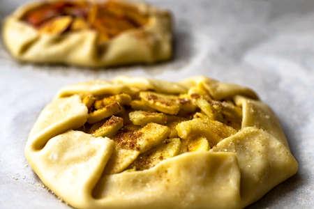 Apple galette crostata sweet cake pie on wrinkled backing paper step before backing 写真素材